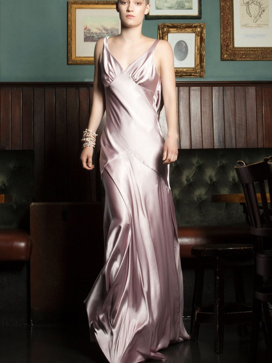 Gown cut in lustrous blush-pink satin cut in bias to skim over the body by Petriiski